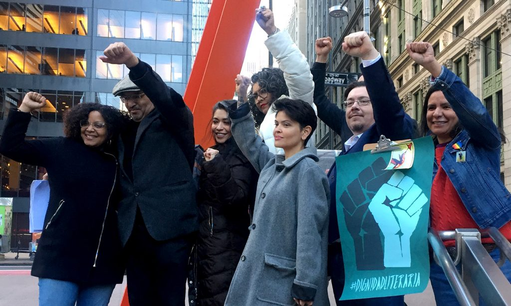 """Hispanic writers raise theirs fists after meeting with the CEO of MacMillan USA and executives of its division Flatiron to protest the publication of the novel """"American Dirt"""" in New York City on February 2, 2020. - The writers have created a new movement called Dignidad Literaria to push for more diversity in the publishing industry, both in terms of staff and number of books published by Hispanic authors. (Photo by Laura BONILLA CAL / AFP) (Photo by LAURA BONILLA CAL/AFP via Getty Images)"""